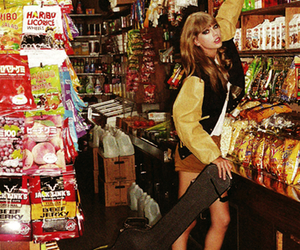 Taylor Swift, guitar, and magazine image