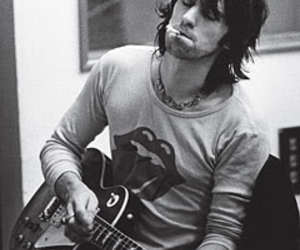 Keith Richards, rolling stones, and guitar image