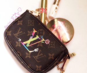 Louis Vuitton, mac, and YSL image