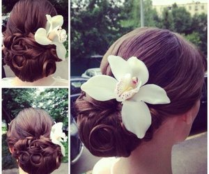 hairstyle, flower, and girl image