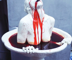 bleeding, fountain, and statue image