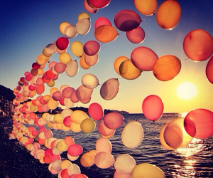 balloons, sea, and sun image