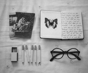 cigarette, book, and glasses image