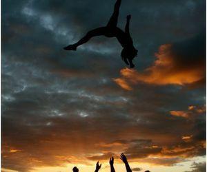 cheerleading, cheer, and sunset image