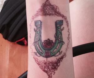 horseshoe and tattoo image