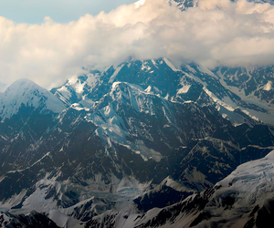 mountains, clouds, and snow image