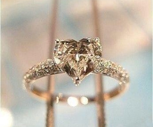 gold, ring, and heart shaped ring image