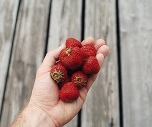 strawberry and hand image