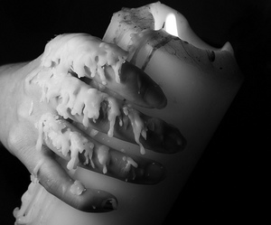candle, hand, and black and white image