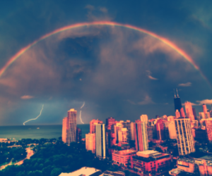 city, rainbow, and sky image