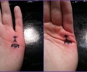 tattoo, jump, and hand image