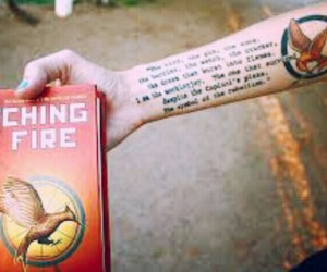 book, tattoo, and catching fire image