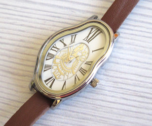 brown watch, leather strand, and leather accessories image