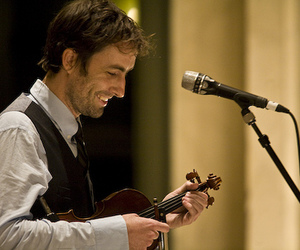 andrew bird, fiddle, and microphone image