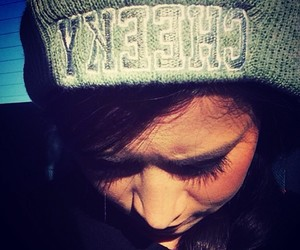 beanie, brunette, and cheeky image