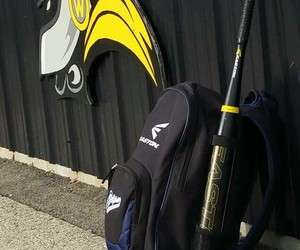 bat, cleats, and softball image