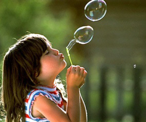 child and bubbles image