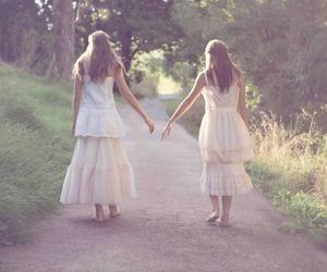 hand in hand, sisters, and zusjes image