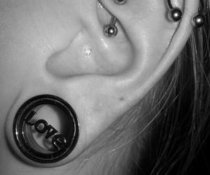 body art, ear, and Piercings image