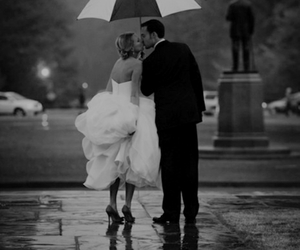 wedding, rain, and kiss image