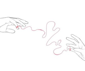 hands and red thread image