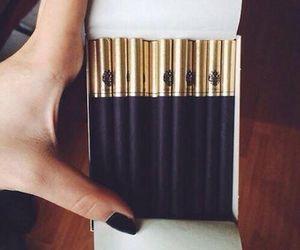 black, cigarette, and gold image