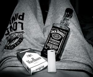 jack daniels, marlboro, and black and white image