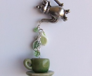 necklace, cup of tea, and tea image