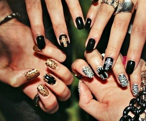 nails, cross, and zebra image