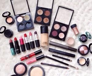eyeshadow, fondation, and lipstick image