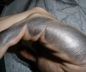 hand, metallic, and silver image