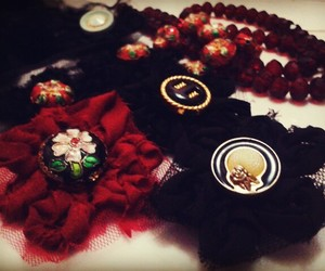 black, brooch, and buttons image