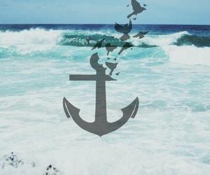 sea, anchor, and bird image