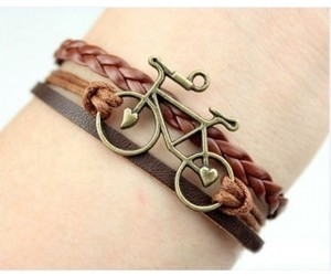 fashion bracelet, brown bracelet, and braided wax cords image