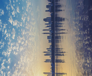 city, sky, and water image