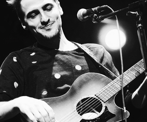 black and white, dimples, and guitarist image