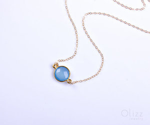 gold necklace, gemstone necklace, and birthstone necklace image