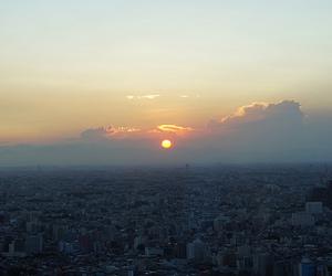 city, landscape, and sun image