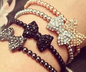 bracelet, gold, and bow image