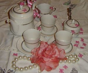 tea buteerflies and pearls and rose image