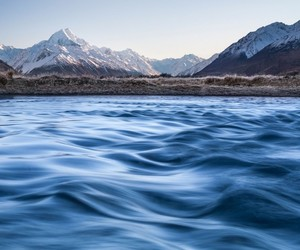 mountains, sky, and water image