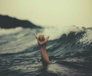 sea, ocean, and hand image