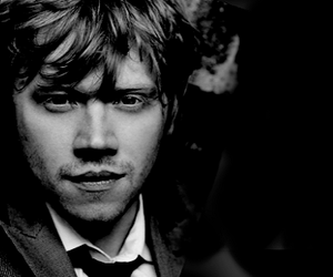 rupert grint, harry potter, and black and white image