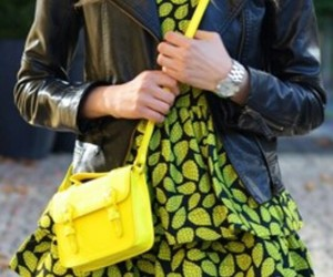 yellow purse, silver watch, and black pants image