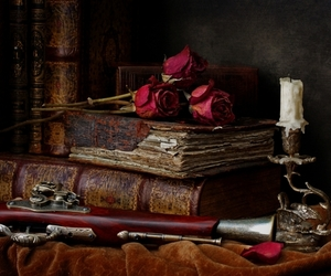 book, rose, and candle image