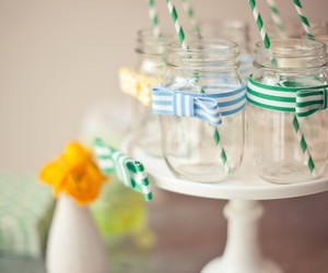 mason jars, ribbon, and straw image
