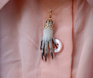 necklace, monster, and hand image