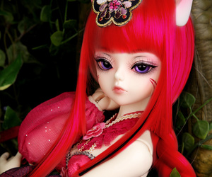 ball jointed doll, cat ears, and red image