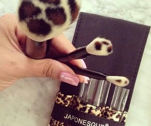 Brushes, makeup, and leopard image