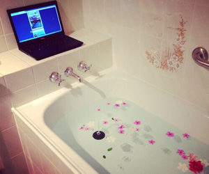 bath, flowers, and laptop image